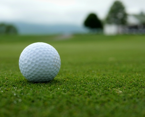 white-golf-ball-on-green-grass-field-4475588